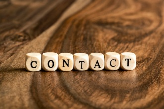 CONTACT word background on wood blocks